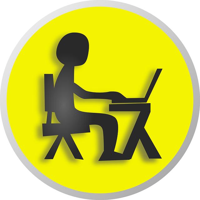 Blogger Sitting at a Desk