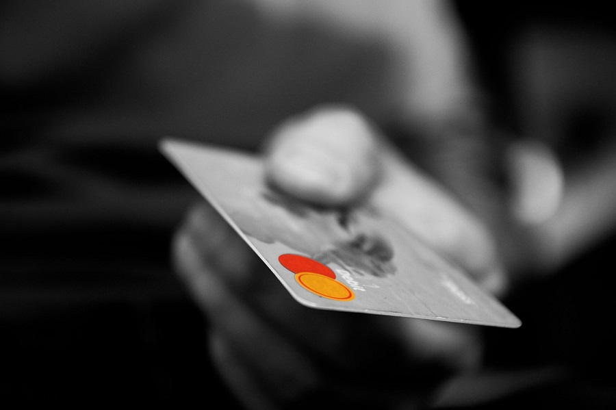 Photo of a Man Holding a Credit Card