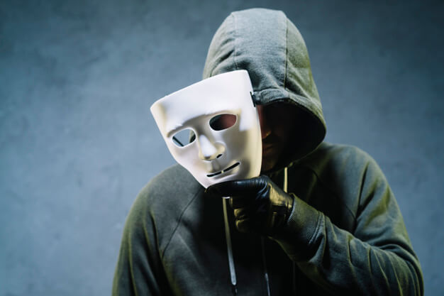 hacker-holding-mask_23-2147985363
